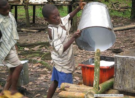 Child working at Liberian rubber plantation - International Labor Rights Fund